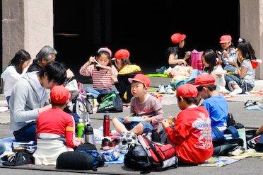 Schoolkids eating their bento