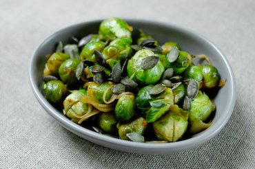 Smoky Brussels Sprouts with Onions and Squash Seeds