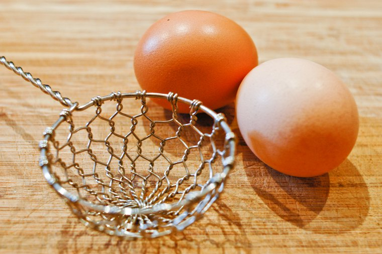 Raw eggs and the nifty basket I use to lift them out of the water.