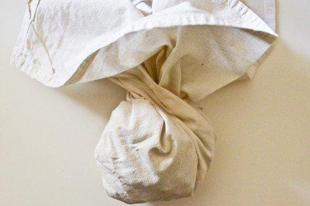 Roasted hazelnuts in bundled towel