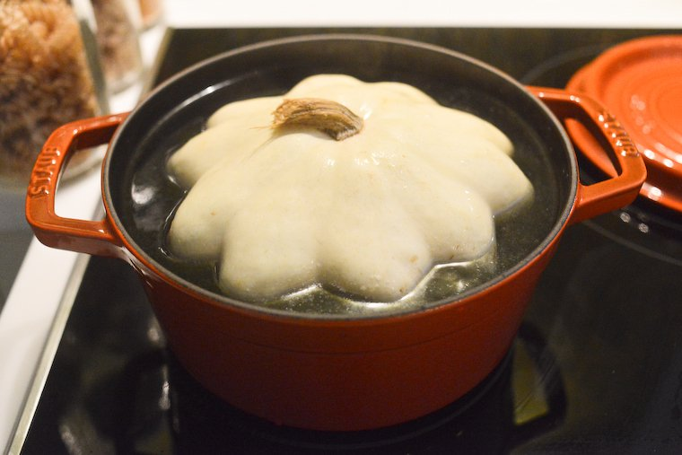 Pattypan squash taking a simmering bath in my 4-quart Staub cocotte.