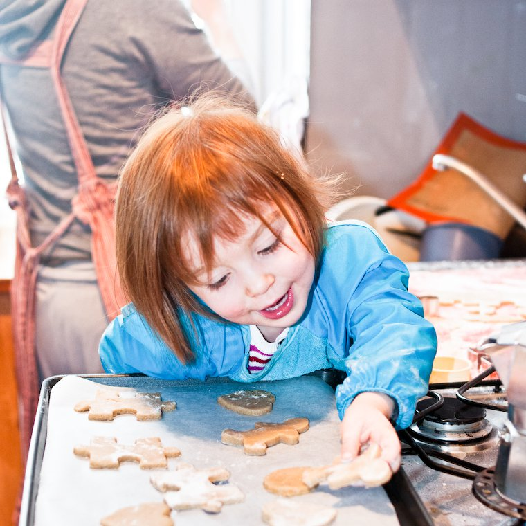 Olivia making cinnamon cookies