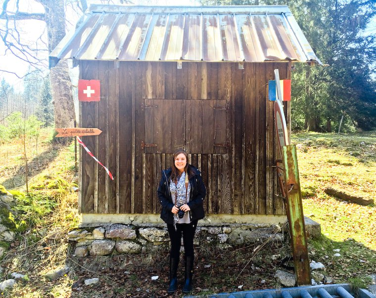 Anne Elder, standing right at the border between France and Switzerland.