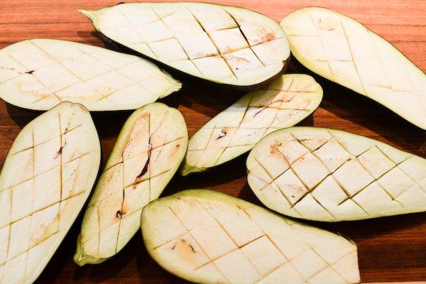 Score the eggplant flesh